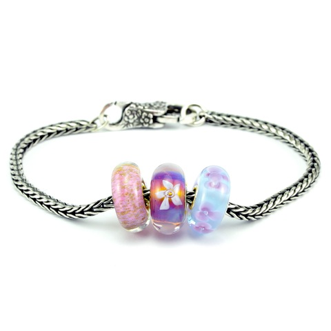 Don't know what beads she likes? Why not chose this beautifully feminine Trollbeads Floral Romance Glass Bead Bracelet. You can buy the beads individually or make life easy for yourself by choosing this stunning ready-made bracelet. If you buy the beads and bracelet separately it is £155 but NOW it is £140