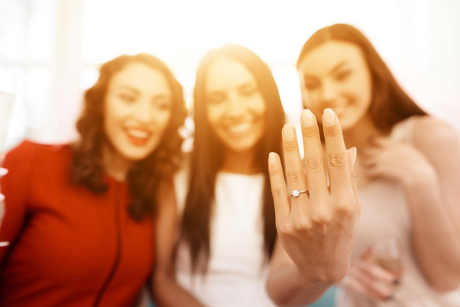 Woman showing friends her engagement ring