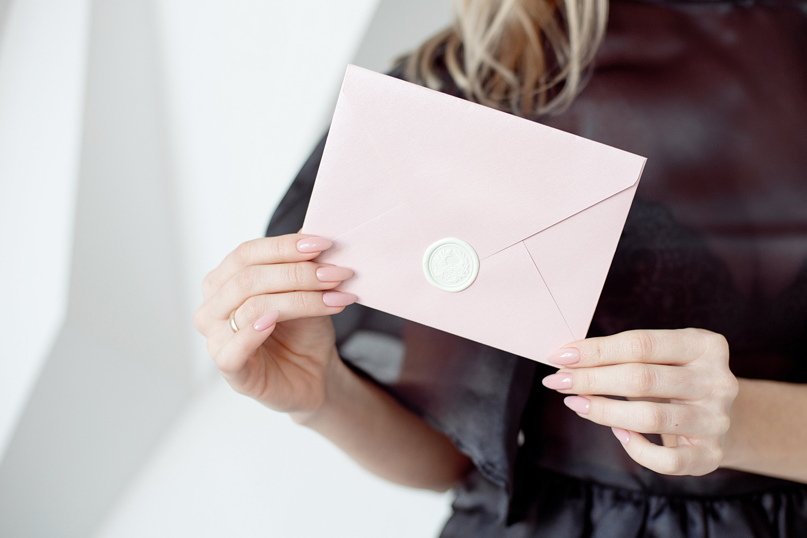 woman holding an envelope