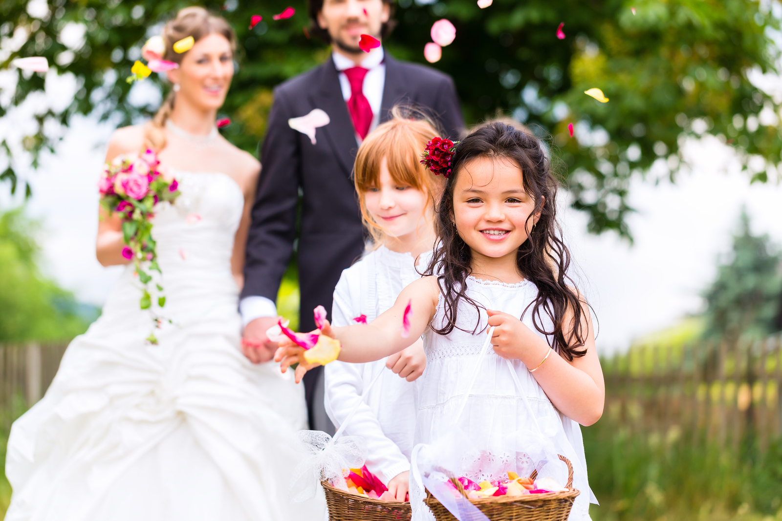bride and groom at wedding with children