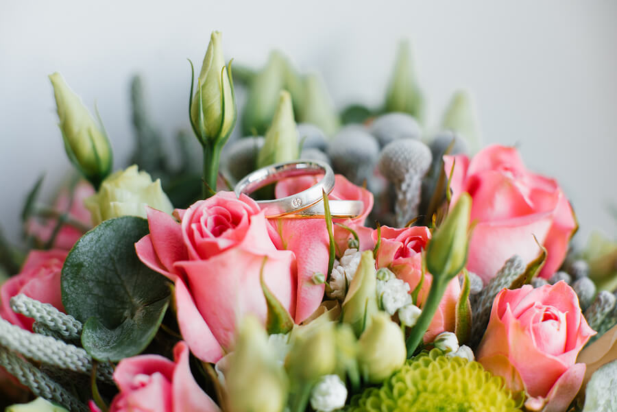 wedding rings on a flower bouquet