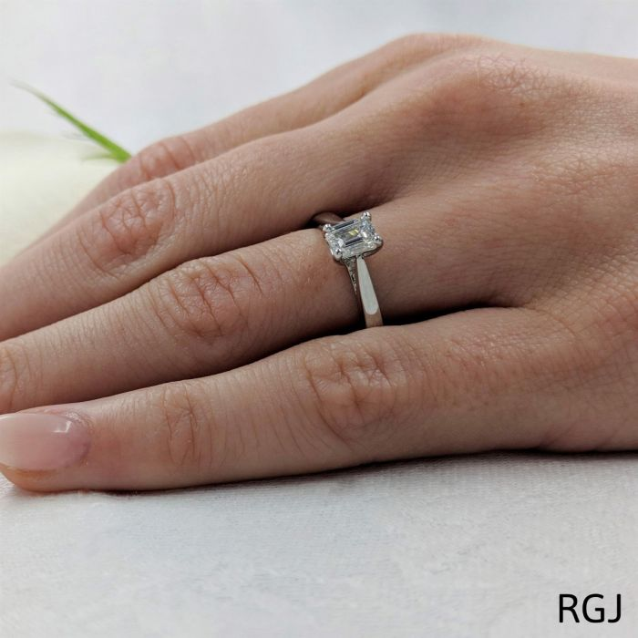 A diamond solitaire engagement ring on a woman's hand