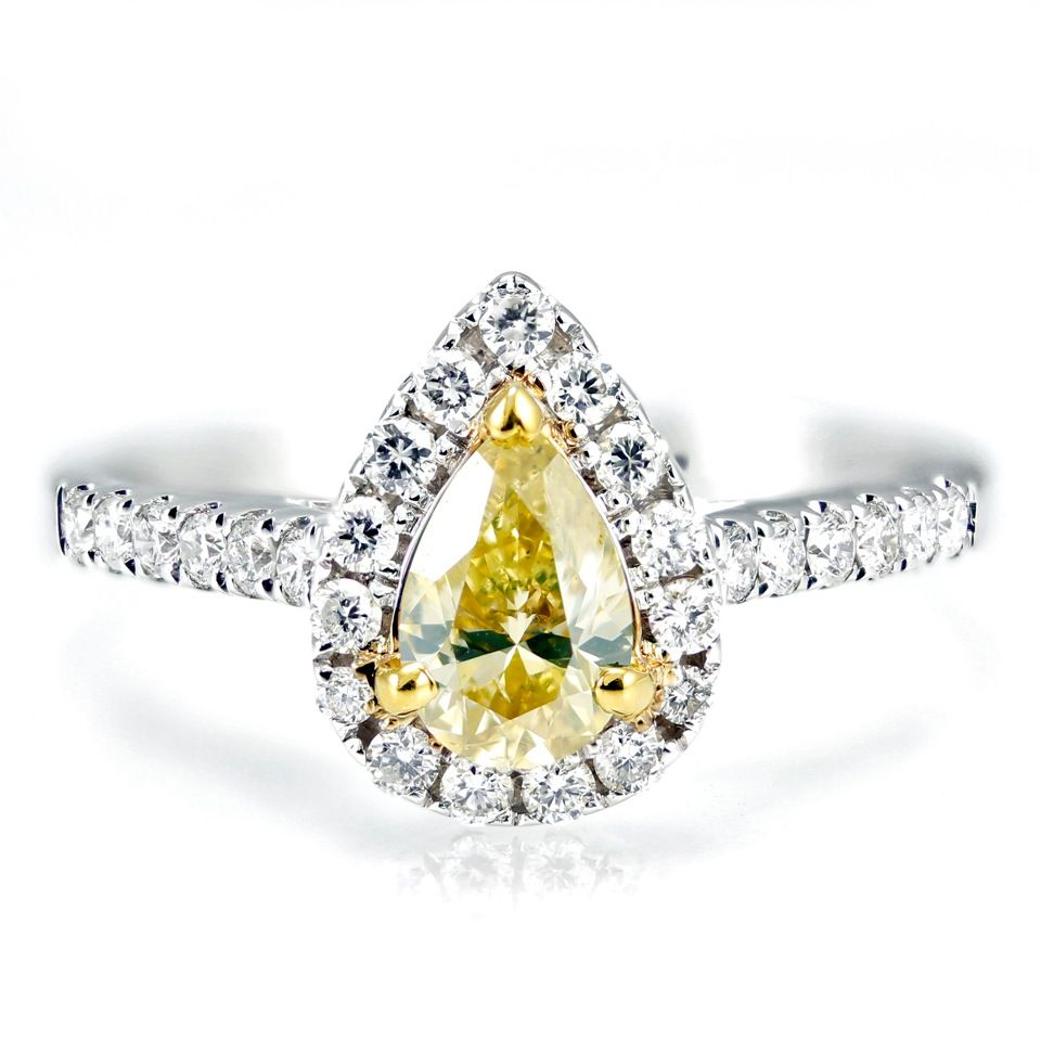 Pear shaped yellow diamond engagement ring with halo