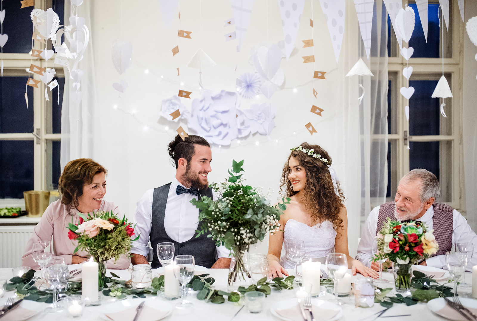married couple at wedding with parents