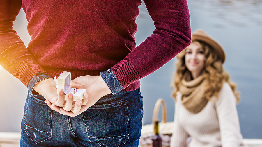 surprise wedding proposal with engagement ring