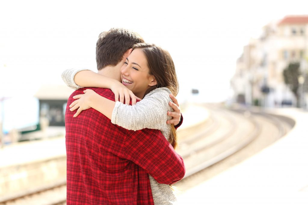 A couple hugging after engagement proposal