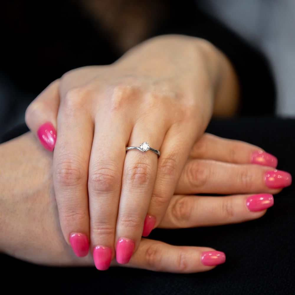 engagement ring with hands